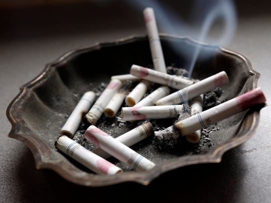 Burning cigarettes in an ashtray