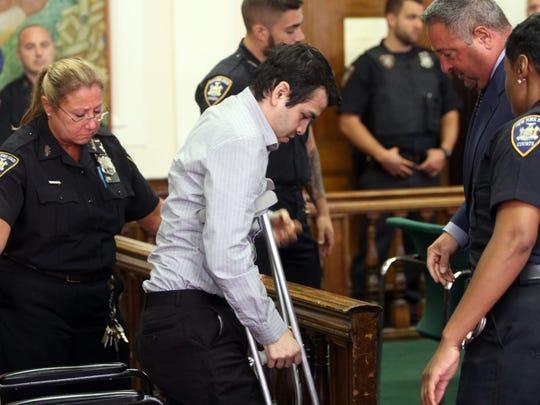 Linden police officer Pedro Abad Jr. is arraigned,