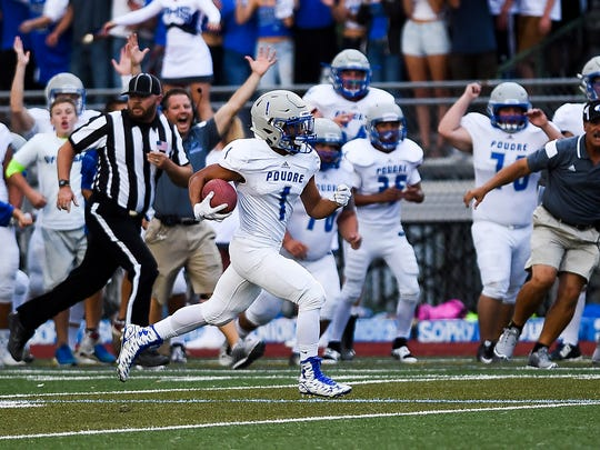 Poudre's Earl Ong returns the opening kickoff for a touchdown against Fort Collins last season at French Field.