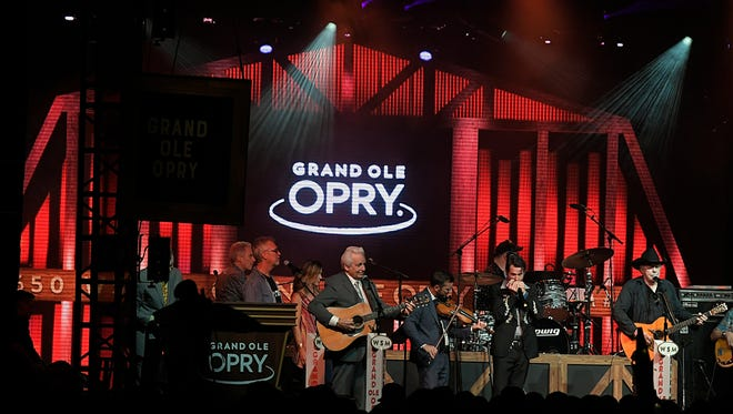 Del McCoury and Bobby Bare sing during the Grand Ole Opry show on the final night of the 17th annual Bonnaroo Music and Arts Festival in Manchester, Tenn., on June 10, 2018