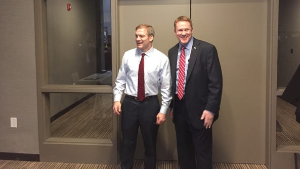 Rep. Jim Jordan, left, poses for a picture with congressional