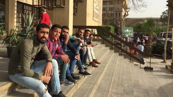 Cairo University undergraduates take a break outside