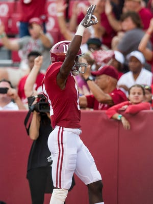 Alabama wide receiver Henry Ruggs III (11) celebrates after scoring a touchdown against Fresno State in second half action at Bryant Denny Stadium in Tuscaloosa, Ala., on Saturday September 9, 2017.
