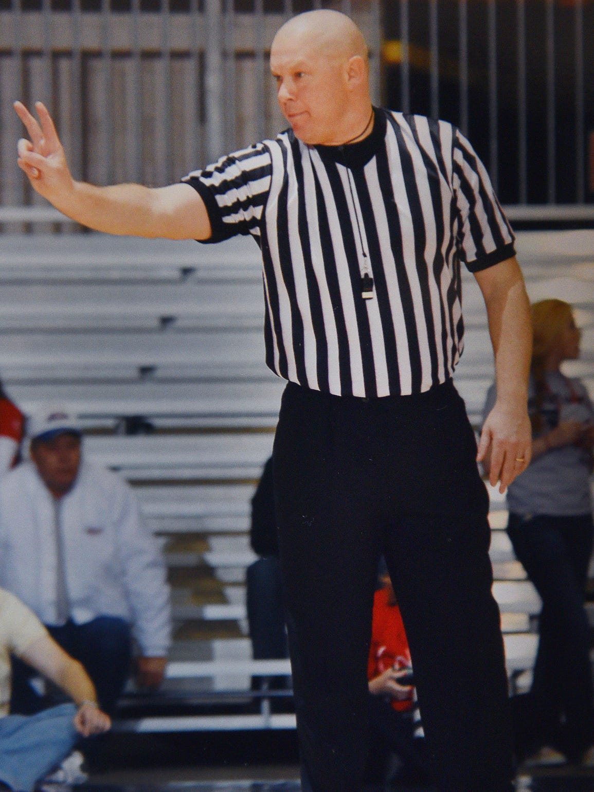 Referee Jeff Schroder shows a photo taken in 2012 of