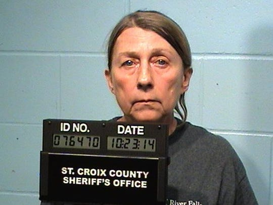 This undated image provided by the St. Croix, Wis., County Corrections Bureau shows Cheryl Kloss. Cheryl and her husband, Kelly Kloss, are accused of conspiring to kill a River Falls police officer and threatening to harm a St. Croix County judge. (AP Photo/St. Croix, Wis., County Corrections Bureau)