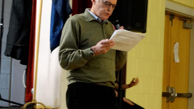 Charlotte Selectboard Chairman Lane Morrison explains the budget during town meeting Tuesday, March 1, 2016, at the Charlotte Central School.