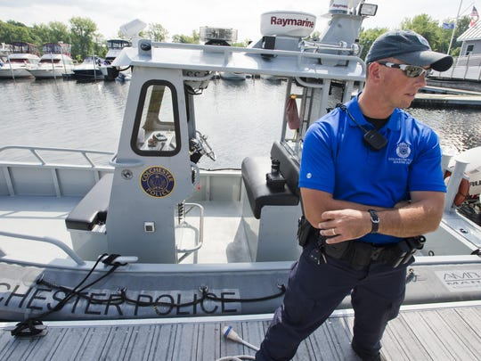 Colchester Police Department Marine Patrol Cpl. Michael Akerlind speaks at Malletts Bay last August following a search for a missing boater. Akerlind was also part of a search Saturday night for a man who had crashed his boat. The man later turned himself in.