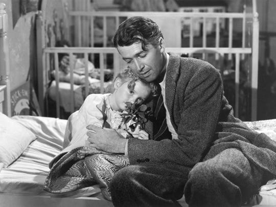 Karolyn Grimes with Jimmy Stewart in 'It-s a Wonderful Life'.