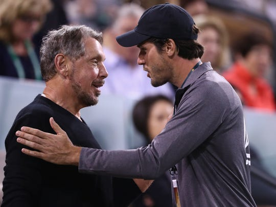 BNP Paribas Open owner Larry Ellison, left, talks with Tommy Haas as they watch the tennis during day four of the BNP Paribas Open at Indian Wells Tennis Garden on March 10, 2016.
