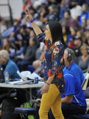 Exeter head coach Samantha Hilvers gives signs during the  Bakersfield Christian in a Central Section Division II girls volleyball championship game at COS on November 11, 2017