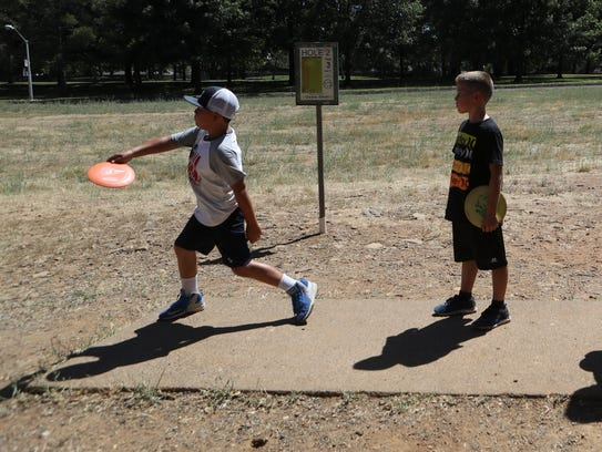 Johnathan Pobes, 10, from left, Caden Kitchen, 8, and