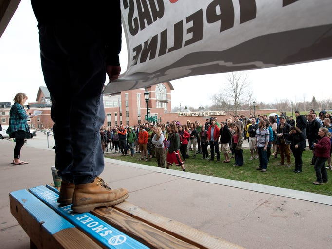 Speakers from Greenpeace, 350VT and various University of Vermont groups rally on Earth Day outside of Bailey Howe Library to address the proposed Vermont Gas pipeline and fossil fuel divestment.