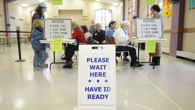 People register to vote at First United Presbyterian Church in De Pere
