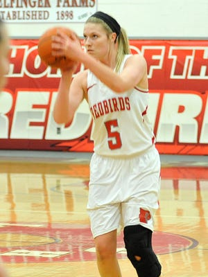 Loudonville senior center Andie Heffelfinger lines up a shot against St. Peter's last week. Heffelfinger was an All-Ohioan a year ago and has returned from off-season knee surgery.