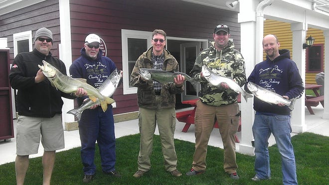 A group of Dan Welsch's clients had a great day on Lake Michigan