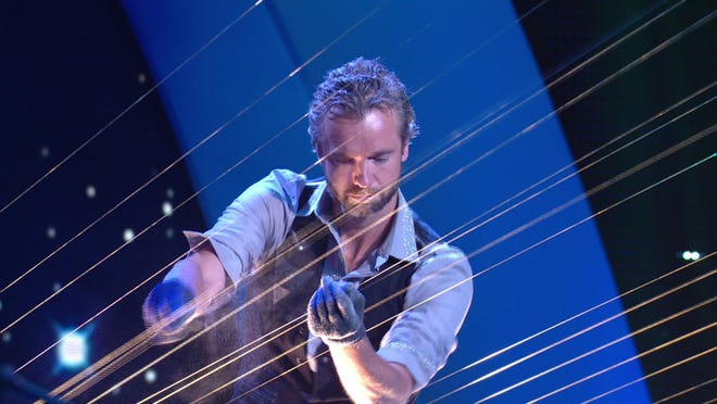 The Earth Harp is the largest stringed instrument on the planet. It was developed by William Close in 1999. The body of the instrument rests on the stage and the strings travel out over the audience attaching to the back of the theater, turning the theater / concert hall, architecture and landscape into the instrument.