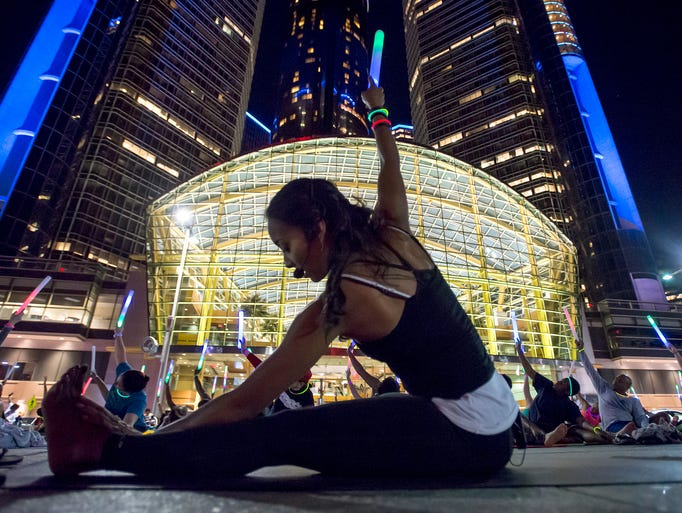 "Yoga instructor Michelle Moten leads the ""moonlight"