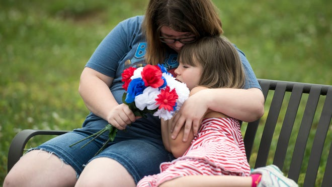 Hannah Buhl, left, and sister Victoria visit East Tennessee State Veterans Cemetery Memorial Day, Monday, May 28, 2018 with their mother Lisa Buhl. Buhl is the CEO of Mending A SoldierÕs Heart, a non-profit organization that provides ministry and social services to veterans.