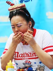 Mary Bowers competes in a Nathan's Famous hot dog eating