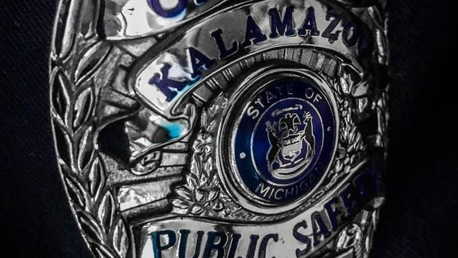 A prosecutor says two Kalamazoo city police officers were justified in fatally shooting a man who tried to ambush them