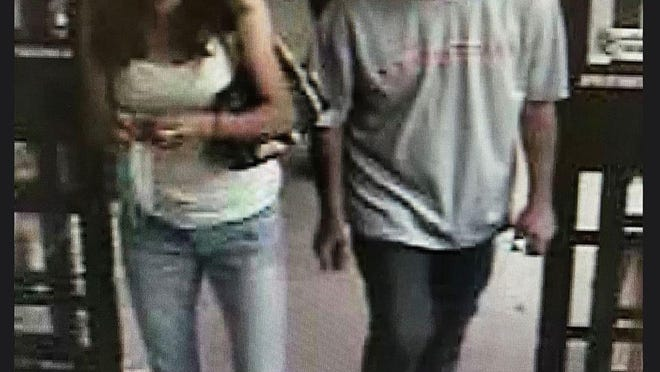 The Cranston police say the woman in this photo distracted an 83-year-old shopper while the man stole  her wallet.
