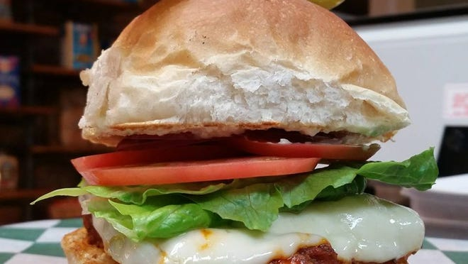 The Speakeatery serves up The Hot Rod, a sandwich of fried chicken coated with house-made Buffalo sauce and topped with muenster cheese, lettuce, tomato, red onion and ranch or blue cheese-celery puree.