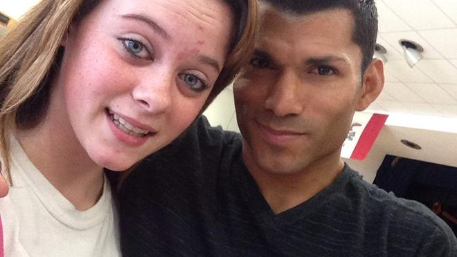 Raven Adams, left, and David LaVera smile in a photo that was posted on Facebook.