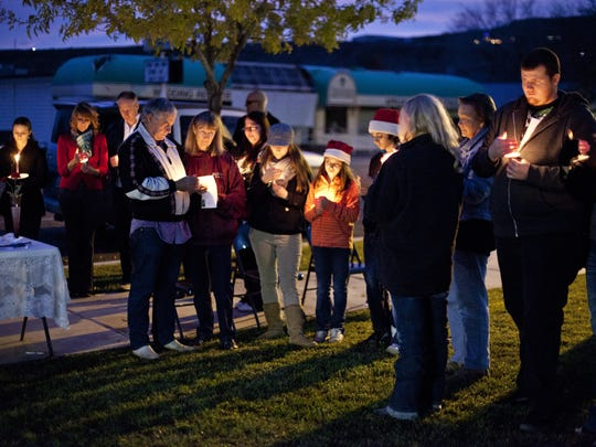 A candlelight vigil held in remembrance of Jerrica Christensen is held at the Washington County Courthouse Thursday, Dec. 11, 2014.