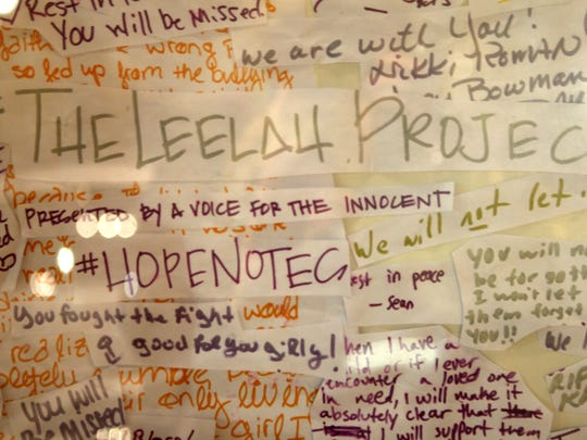 Numerous supportive signs decorated the walls of The Woodward Theater during a vigil to remember Leelah Alcorn in Cincinnati Jan. 10 , 2015.