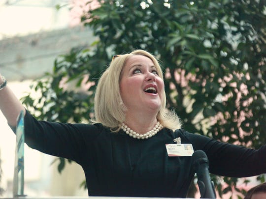 Augusta Health CEO Mary Mannix congratulates staff on a Best 50 American Hospitals award bestowed by Healthgrades acknowledging the hospital for clinical excellence on Tuesday.