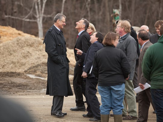 Gov. Shumlin looks up at new AT&T cellular equipment on the side of a silo at a family farm in Richmond before a press conference in April 2015.