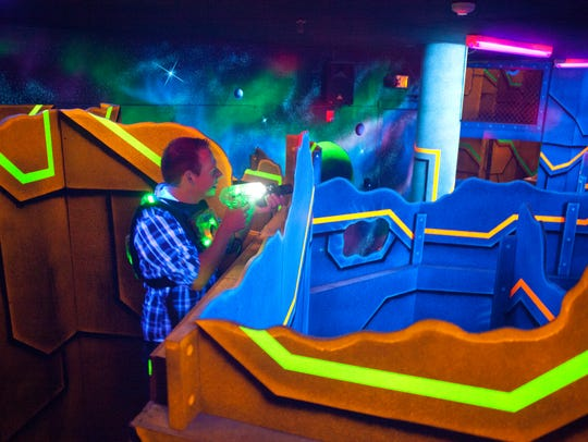 St. George residents play laser tag at Laser Mania