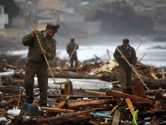 Feb. 27, 2010: 500 dead in Chile. Police officers search