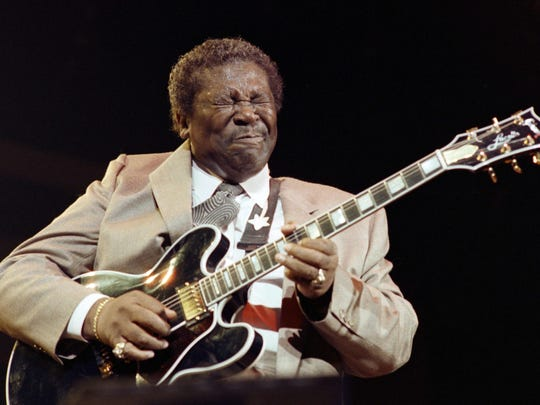 This December 12, 1989 file photo shows American blues musician B.B. King performing at the Bercy concert hall in Paris, France.