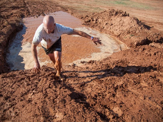 Runners navigate the obstacles on the Hurricane Mud