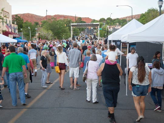 Members of the St. George community enjoy the first George Streetfest Friday, June 5, 2015.