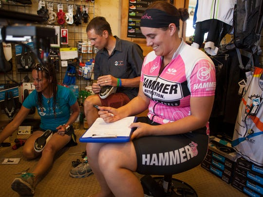 Technicians at IBB Cyclery fit Casie Forbes for a bike