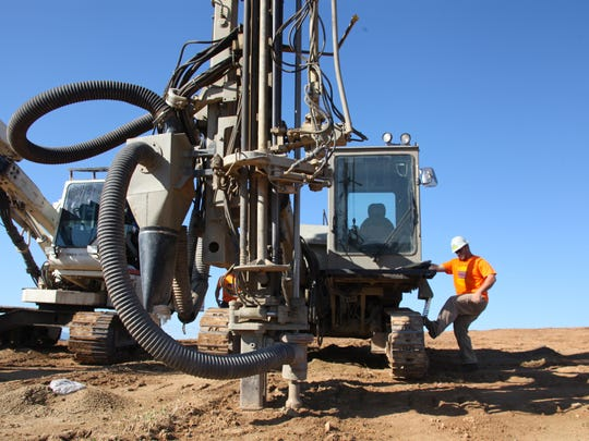 A Virginia Blasting Services employee prepares a drill
