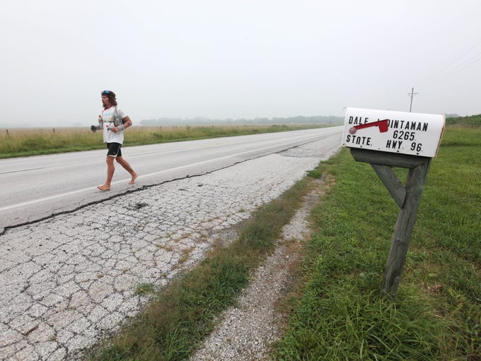 Jake Brown runs toward Avilla on Historic Rt. 66 on
