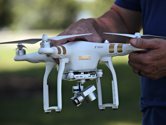 Jason Preston displays one of his drones, the DJI Phantom 3 Professional.