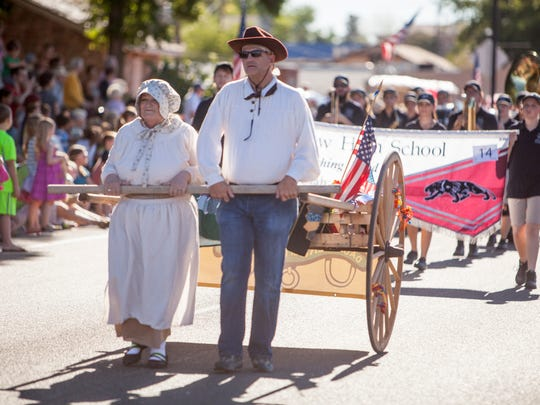 Residents line the streets in Washington City for the annual Pioneer Day Parade Friday, July 24, 2015.