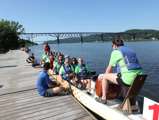 """A dragon boat crewed by team """"Smoke on the Water"""" prepares"""