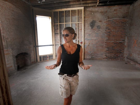 "HGTV host Nicole Curtis of the show ""Rehab Addict"" gives the media a tour of the Ransom Gillis mansion in Detroit's Brush Park district on Thursday, Aug. 6, 2015. The renovation of the historic mansion will be featured in a series featuring Curtis in November on HGTV"