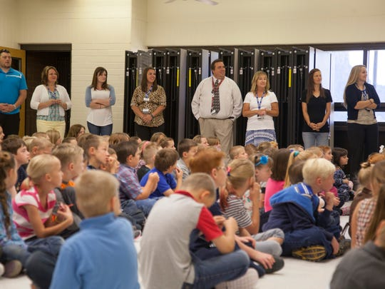 Students at Water Canyon School check in at the start of the school year Thursday, Aug. 13, 2015. Enrollment continues to climb as school officials work to expand facilities.