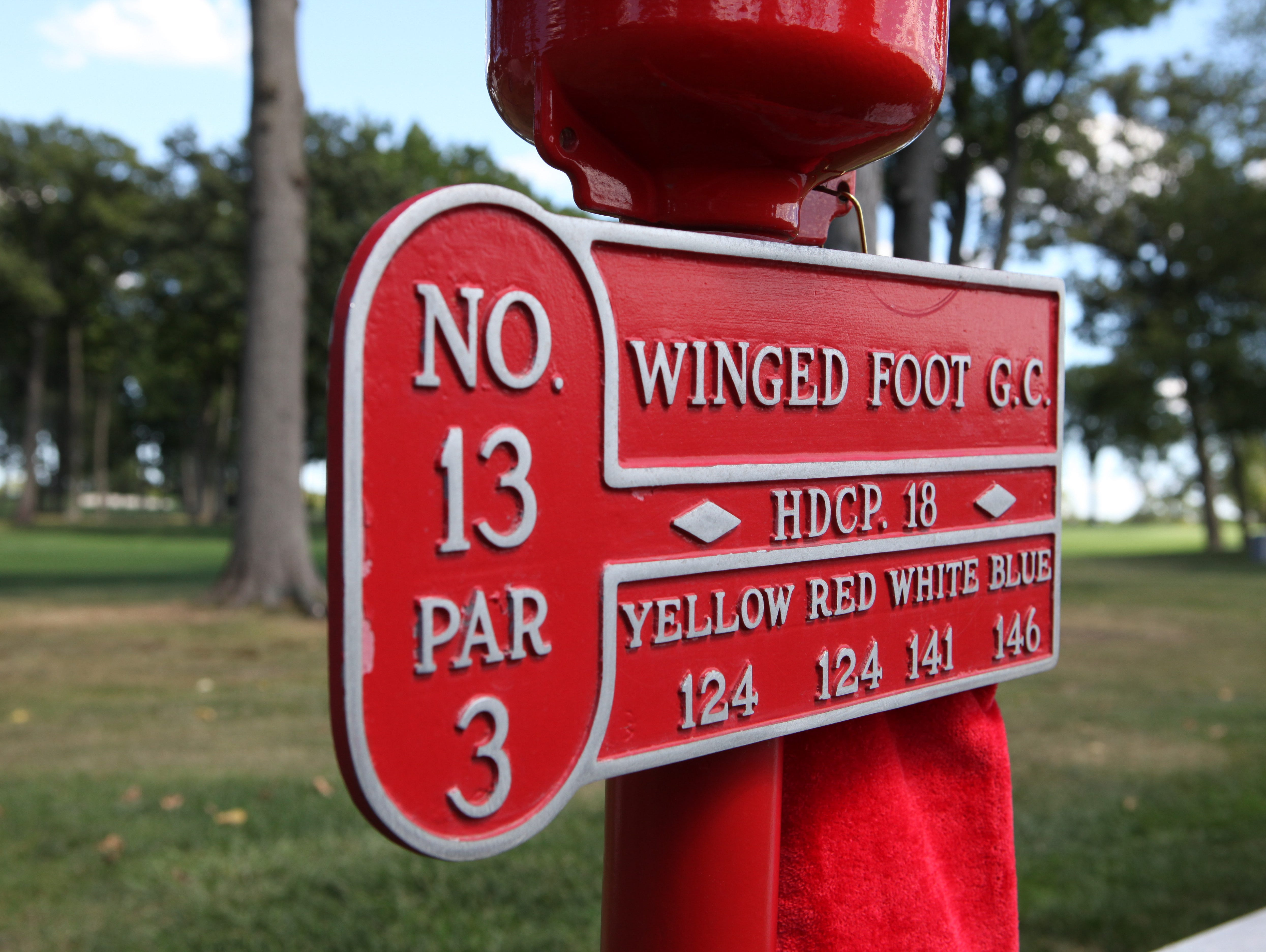 The hole marker for the 13th hole on the East Course at the Winged Foot Golf Club in Mamaroneck, Aug. 13, 2015. The East Course, recently restored, is hosting the USGA Four-Ball Championship next spring.