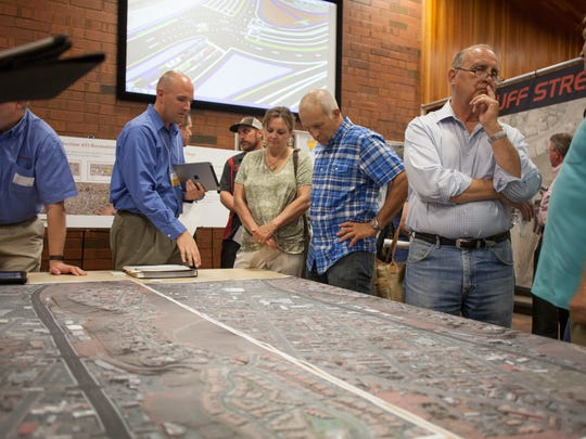 Representatives from the Utah Department of Transportation hold an open house to demonstrate their plans to members of the community Tuesday, Aug. 18, 2015. The overhaul of the intersection near Bluff Street and Sunset Blvd. aims to serve the needs of area businesses, motorists and pedestrians.