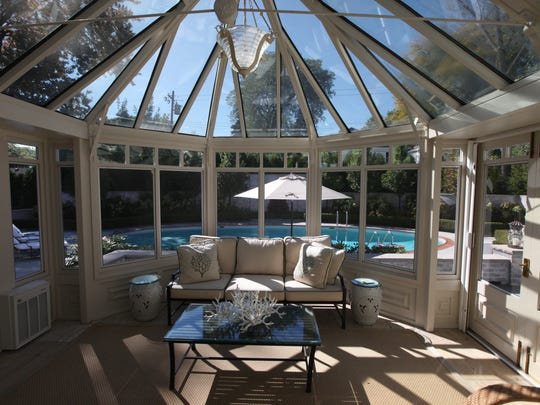 Sunroom with view to the outdoor patio and pool.