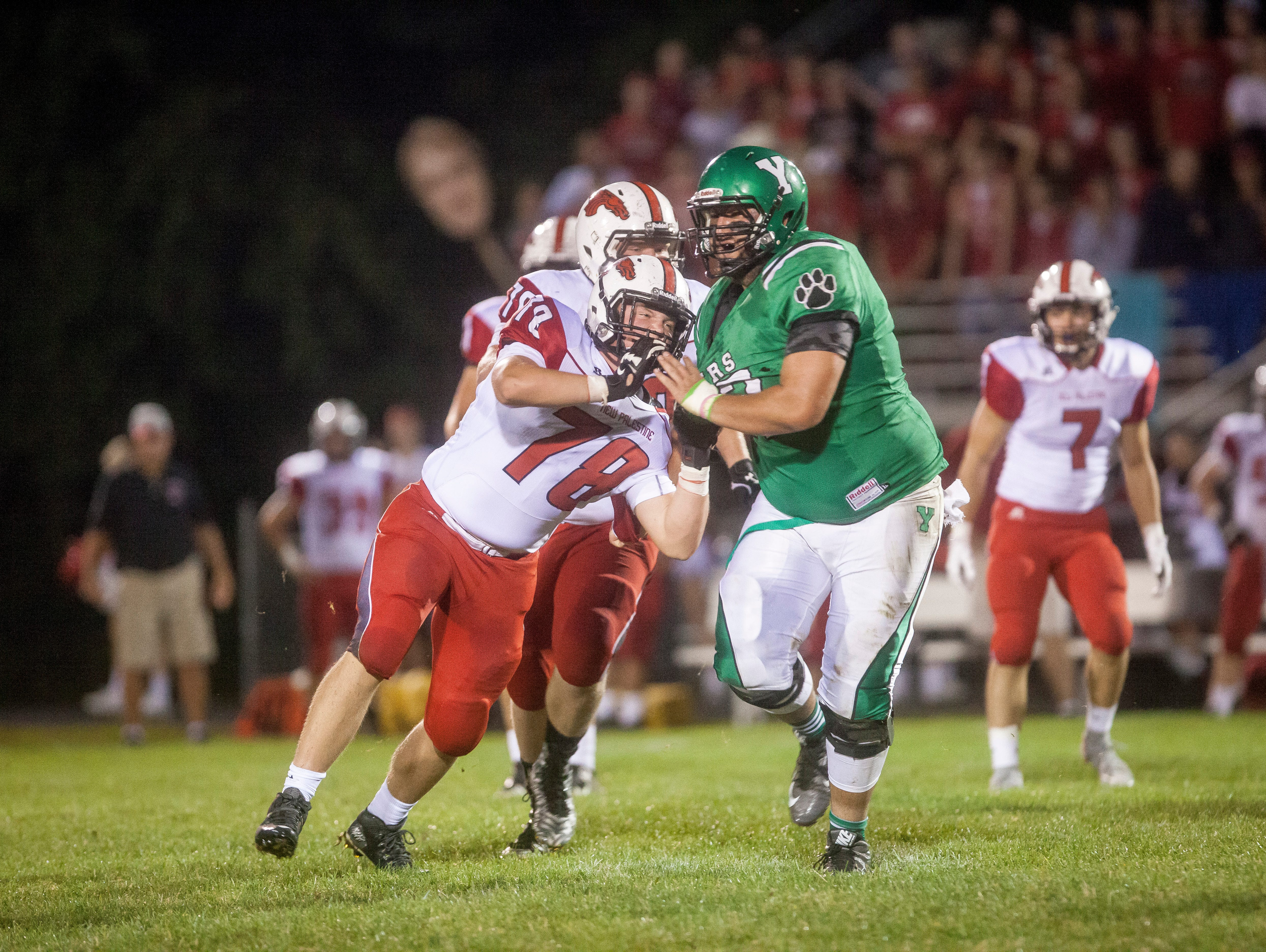 Yorktown lost to New Palestine Friday night in a weather delayed game with a final score of 6-37. Anthony Todd