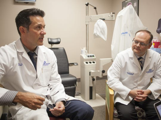 General Ophthalmologist Jason A. Ahee, M.D. and Surgeon Jayson Edwards, M.D. discuss the process of surgically implanting a telescope into the eyes of patients with macular degeneration Thursday, Sept. 3, 2015.
