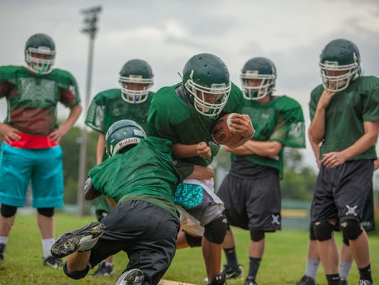 635775077280899014-BUR20150915-Winooski-Highschool-Football-4